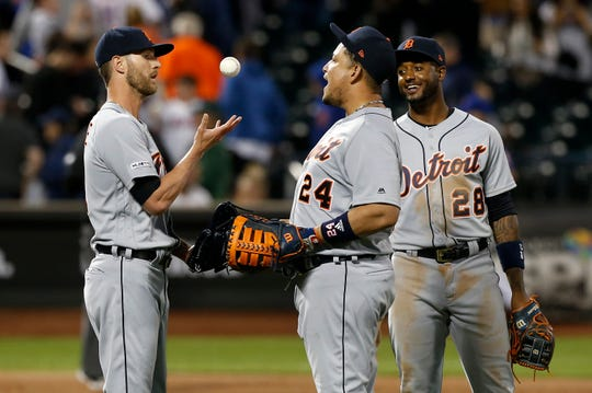 Detroit Tigers closer Shane Greene, left, Miguel Cabrera and Niko Goodrum celebrate the Detroit Tigers' 9-8 win over the New York Mets at Citi Field on May 24, 2019.