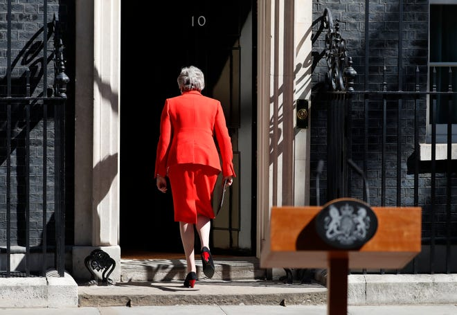 In this Friday, May 24, 2019 file photo, British Prime Minister Theresa May walks away after announcing her resignation, outside 10 Downing Street in London, England.