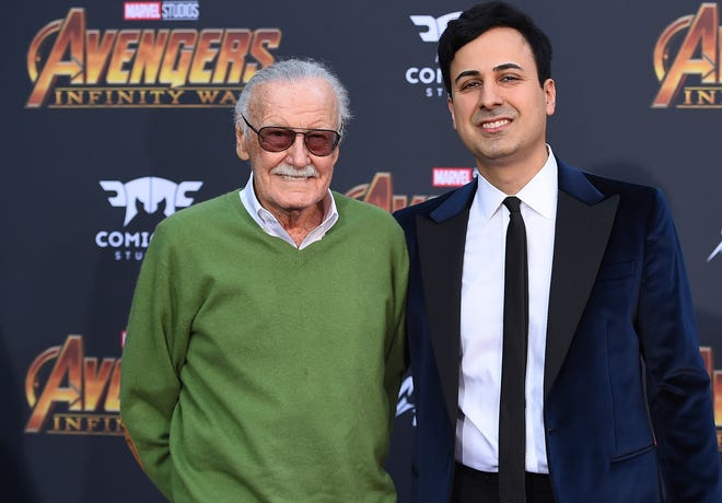 """In this April 23, 2018, file photo, Stan Lee, left, and Keya Morgan arrive at the world premiere of """"Avengers: Infinity War"""" in Los Angeles."""