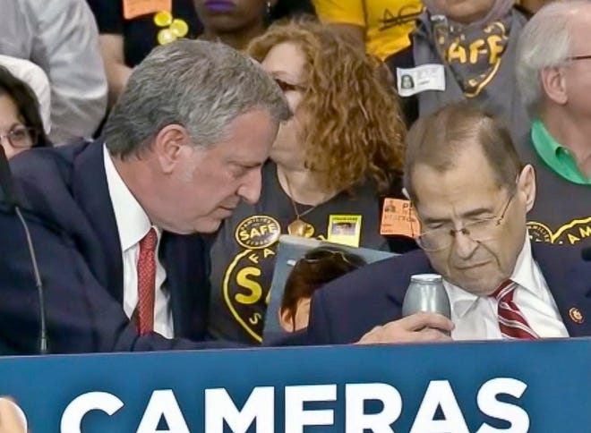 This ABC TV frame grab image from Friday May 24, 2019, shows New York Mayor Bill de Blasio, left, offering a drink to Congressman Jerrold Nadler, right, after he fell ill during a press conference in New York.