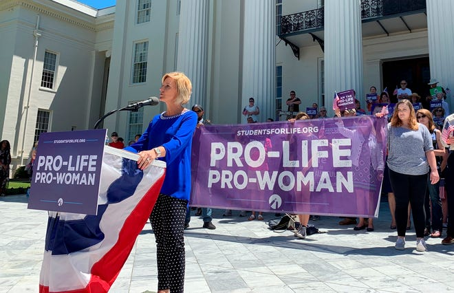 In this May 22, 2019, photo, Beck Gerritson, president of Eagle Forum of Alabama, speaks at an anti-abortion rally outside the Capitol in Montgomery, Ala.