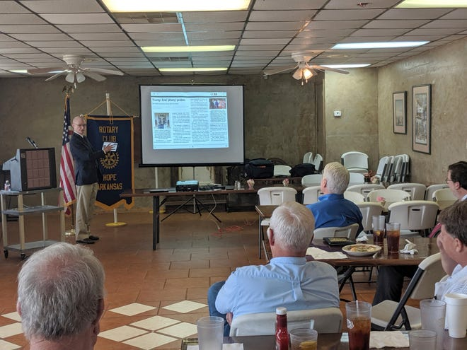 Walter Hussman Jr., publisher of the statewide newspaper the Arkansas Democrat-Gazette, explains to members of the Hope, Arkansas Rotary Club how to access and use the paper's digital replica on an iPad in Hope, Ark.
