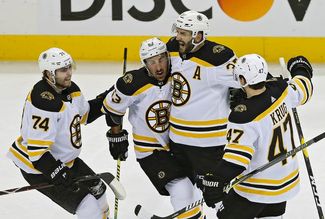 Patrice Bergeron, second from right, can still remember the instant euphoria and accompanying adoration from across New England that came after the Bruins outlasted the Vancouver Canucks in seven games to win the Cup in 2011.