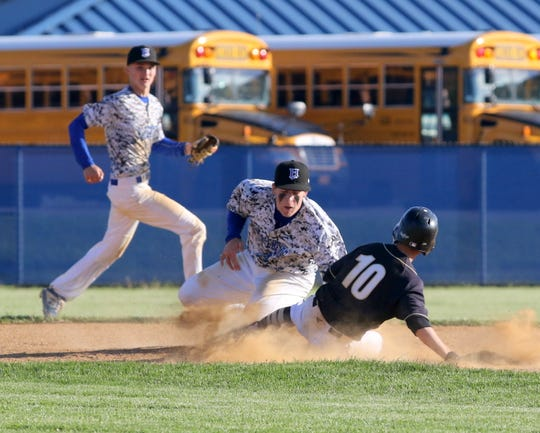 Horseheads second baseman Eli Schooley tags out Corning's Noah Walker on a steal attempt during a Section 4 Class AA baseball semifinal May 24, 2019 at Horseheads High School.