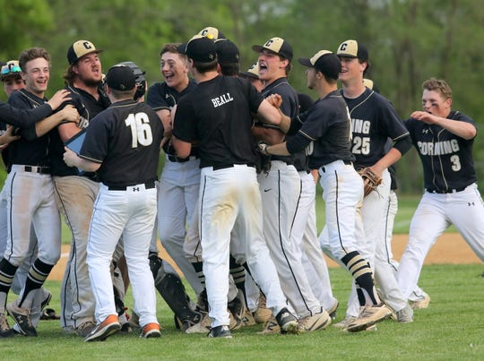 Corning baseball players celebrate their 3-2 win over Horseheads in a Section 4 Class AA semifinal May 24, 2019 at Horseheads High School.