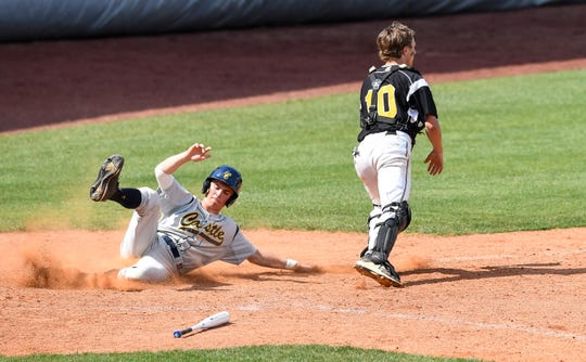 Castle's Blake Herrmann scores as Jasper catcher Ross Peter waits for the throw during the Knights-Wildcats matchup in the second game of the Class 4A sectional semifinals at Bosse Field. Castle won 10-7 and will face Reitz for the title on Monday.
