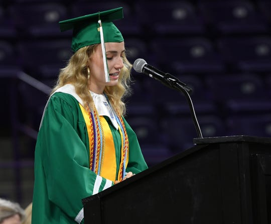 Ryan Finley leads the graduation prayer during the Easley High School graduation in Littlejohn Coliseum in Clemson.