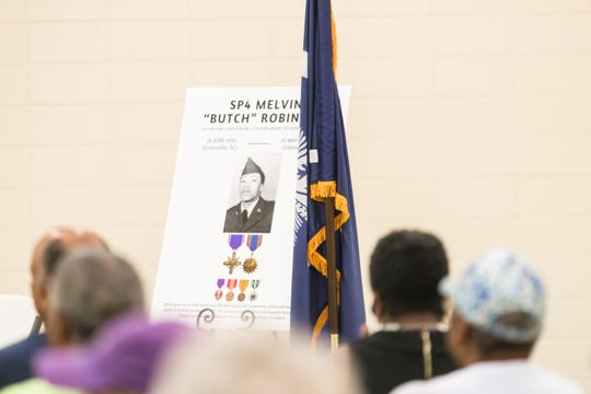 "Members of the West Greenville community gather to honor former West Greenville resident and Purple Heart recipient, Melvin ""Butch"" Robinson, on the 48th anniversary of his death. Robinson, was killed in action in Vietnam on May 25, 1971."