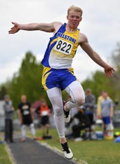 Melstone star Brody Grebe competes in the long jump Friday in Laurel.