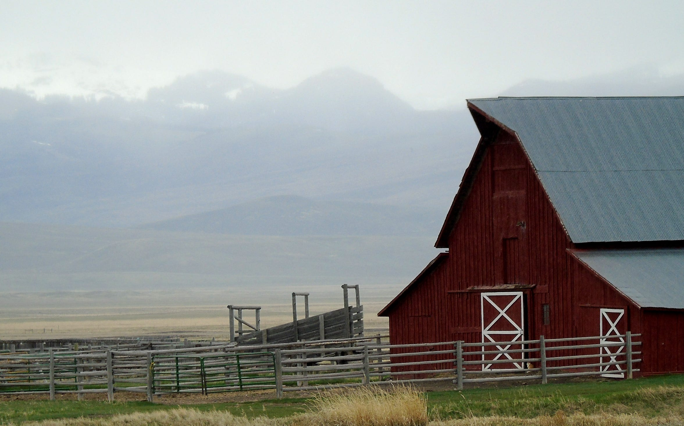 A red barn is part of the landscape in Montana's remote Centennial Valley.