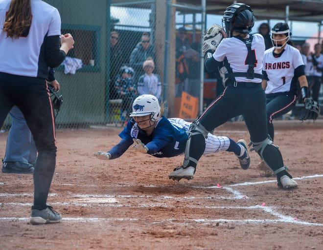 Great Falls High baserunner Rachel Porter makes a dive for home plate during the 2019 Class AA state championship game at Stodden Park in Butte against Billings Senior. The Bison came away with the state title last year, but never got the chance in 2020 due to COVID-19.