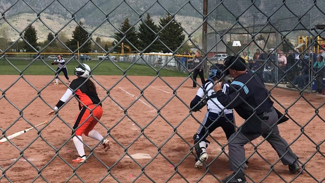 Billings Senior's Kara Conway follows through on a three-run homer in the bottom of the seventh inning, boosting the Broncs to an 8-5 win over the Bison in the semifinals of the Class AA State Tournament Friday at Stodden Park in Butte.