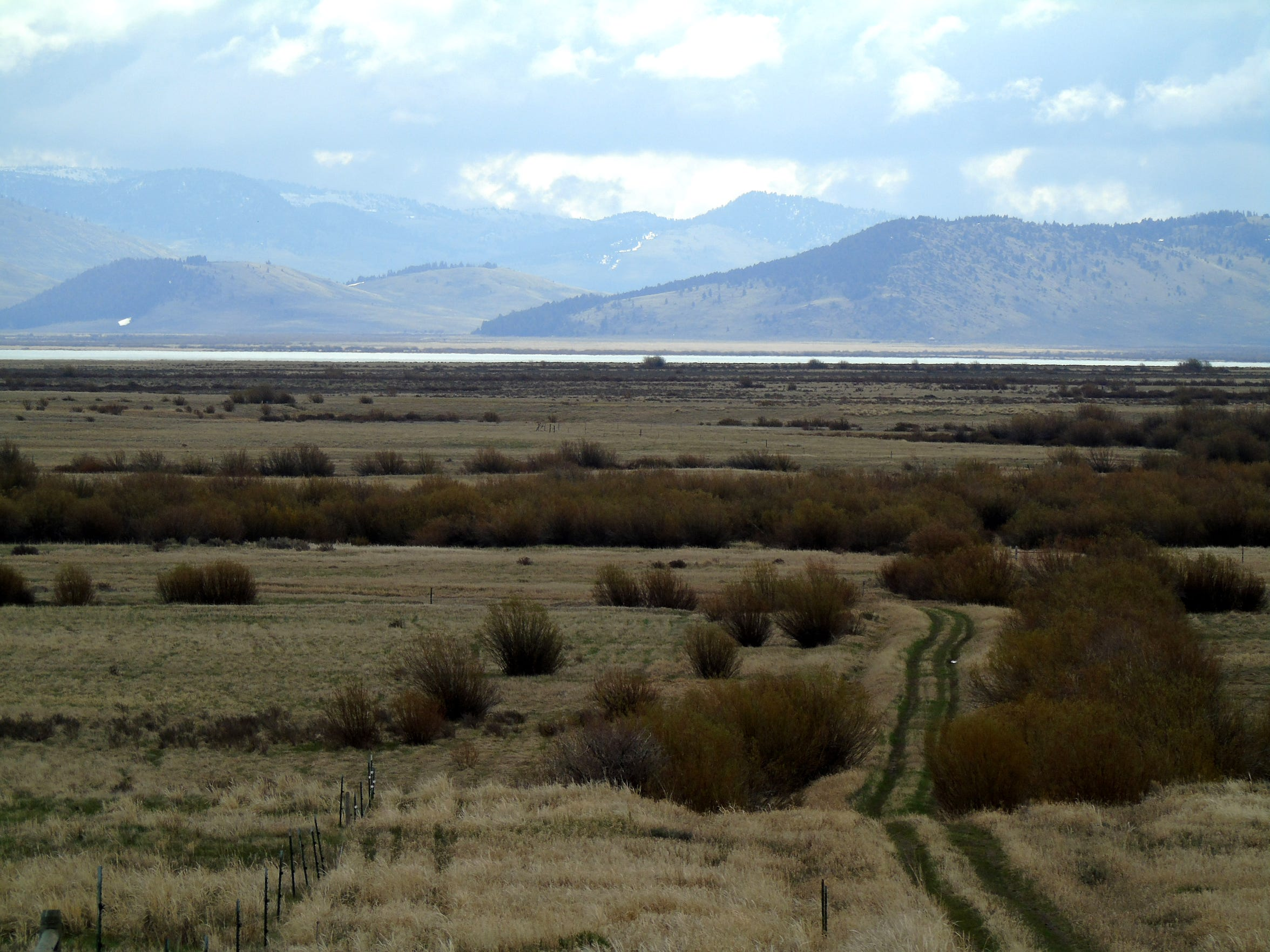 A trail leads into the Red Rock Lakes National Wildlife Refuge in Montana's remote Centennial Valley. Ranching and the refuge are the mainstays of the valley, but backcountry tourism plays a role, too.