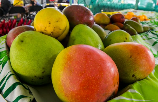 A collection of mangos are displayed during the 13th annual Agat Mango Festival in May 2019.