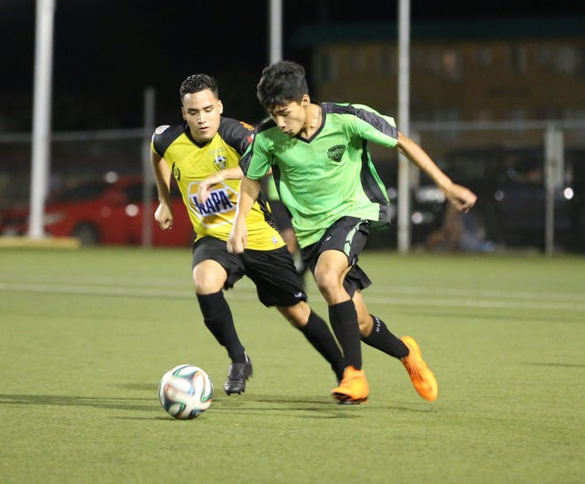 The Islanders FC's Michael Castaneda attempts to speed past NAPA Rovers FC's Gustavo Pro during a semifinal match of the Bank of Guam 12th Annual GFA Cup Thursday at the Guam Football Association National Training Center. The Rovers won 6-4.