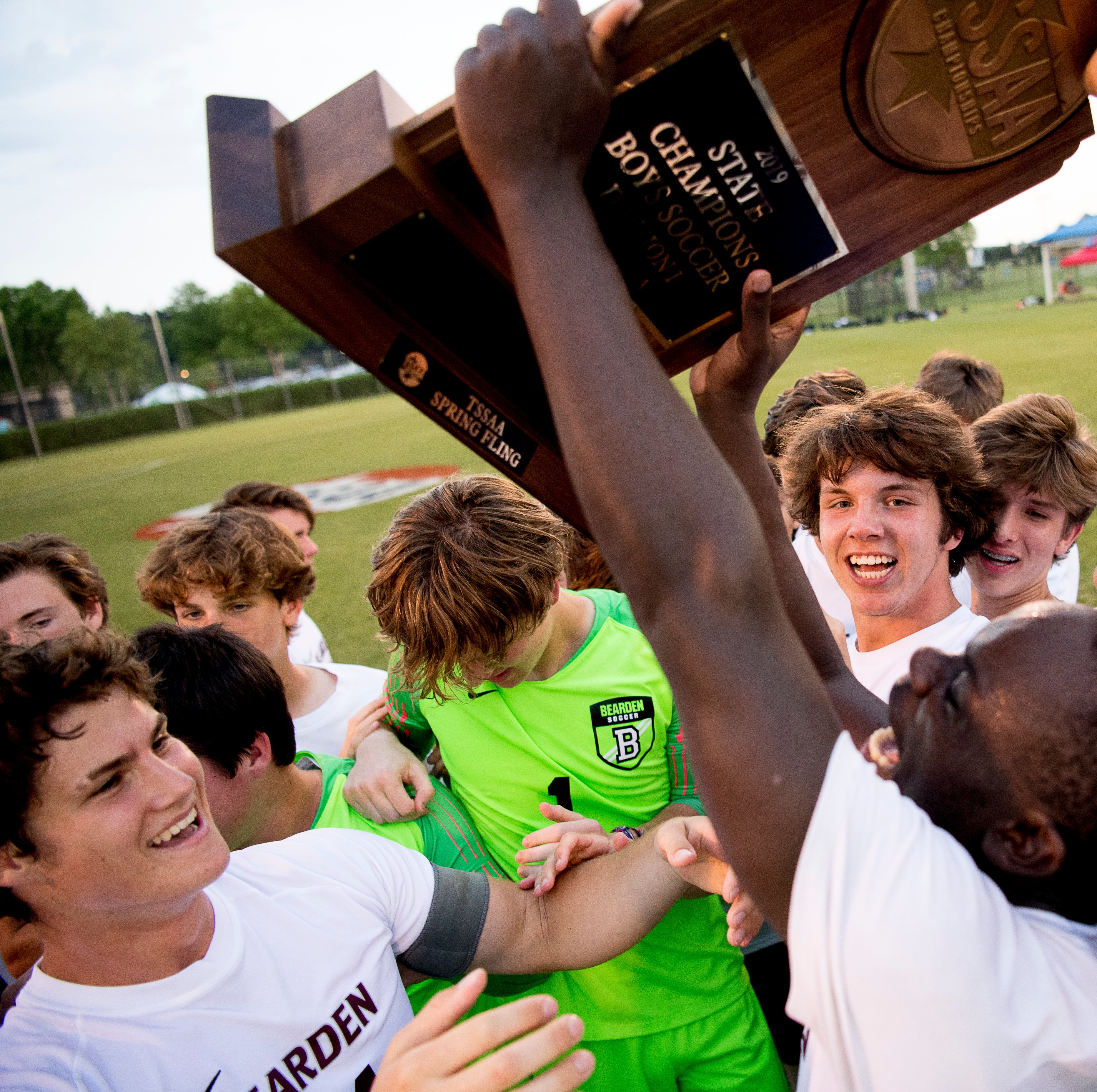 Bearden celebrates with their trophy after defeating Station Camp 4-3 in penalty kicks in a Class AAA championship soccer match at the TSSAA state championships in Murfreesboro, Tennessee on Friday, May 24, 2019.