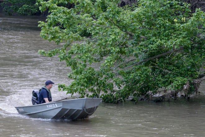 Emergency personnel search Deer Creek, Friday, May 24, 2019, in Delphi.