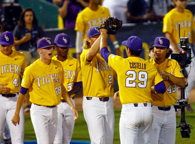 LSU's Chase Costello (29) celebrates with teammates after the team's 12-2 victory over Mississippi State during a Southeastern Conference tournament NCAA college baseball game Friday, May 24, 2019, in Hoover, Ala. (AP Photo/Butch Dill)