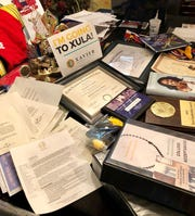 Normandie Cormier of Lafayette has been accepted to more than 100 colleges and awarded millions in scholarships. She's decided to attend Xavier University in New Orleans this fall in her path to become a doctor. This table in her home is full of acceptance letters, awards and other important recognitions.