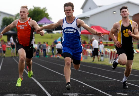 Southeastern's Lane Ruby crosses the finish line during the boys 100 meter dash Friday, May 24, 2019, during the Division III Regional Track and Field Meet at Fairfield Union High School in Rushville.