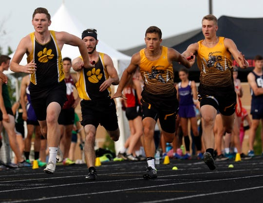 Paint Valley's Justin Draise, left takes the baton from teammate Caleb Adams as Northmor's Aaron Berg takes the baton from Drew Zoll during the boys 400 meter relay Friday, May 24, 2019, during the Division III Regional Track and Field Meet at Fairfield Union High School in Rushville.