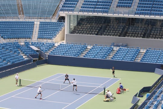 Lexington's Benton Drake and Blake Webster (in white) play on Center Court in the state tennis tournament at the Lindner Family Tennis Center, site of the Western & Southern Open pro tournament.