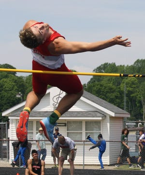 Shelby's Uriah Schwemley clears the bar during the Division II regional high jump competition. He cleared 6-7 to win the regional title and put himself in prime position to repeat as state champ.