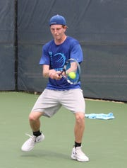 St. Peter's two-time sectional singles champ Luke Henrich hits a backhand during his first round match in the state tennis tournament inside the Lindner Family Tennis Center near Cincinnati.