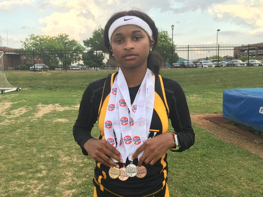 Mitchell senior Miata Borders poses with her four state track medals, including a gold medal for winning the TSSAA DI Small Class 300 meter hurdles