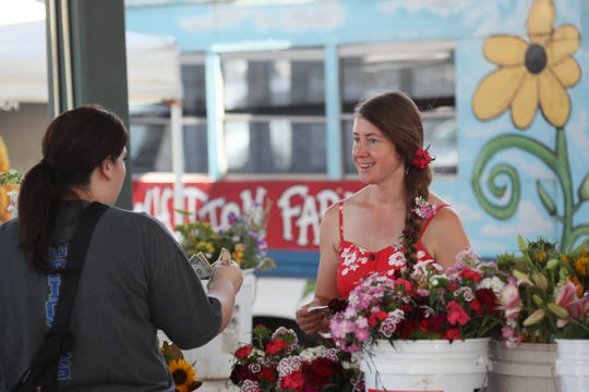 Jill Forrester sells flowers from her fields at Whitton Farms at the Memphis Farmers Market downtown on Saturday, May 25, 2019.