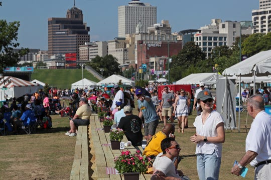 People gather in an attempt to break the world record for longest picnic table during Celebrate Memphis at Tom Lee Park, the culmination of Memphis in May festivities on Saturday, May 25, 2019.