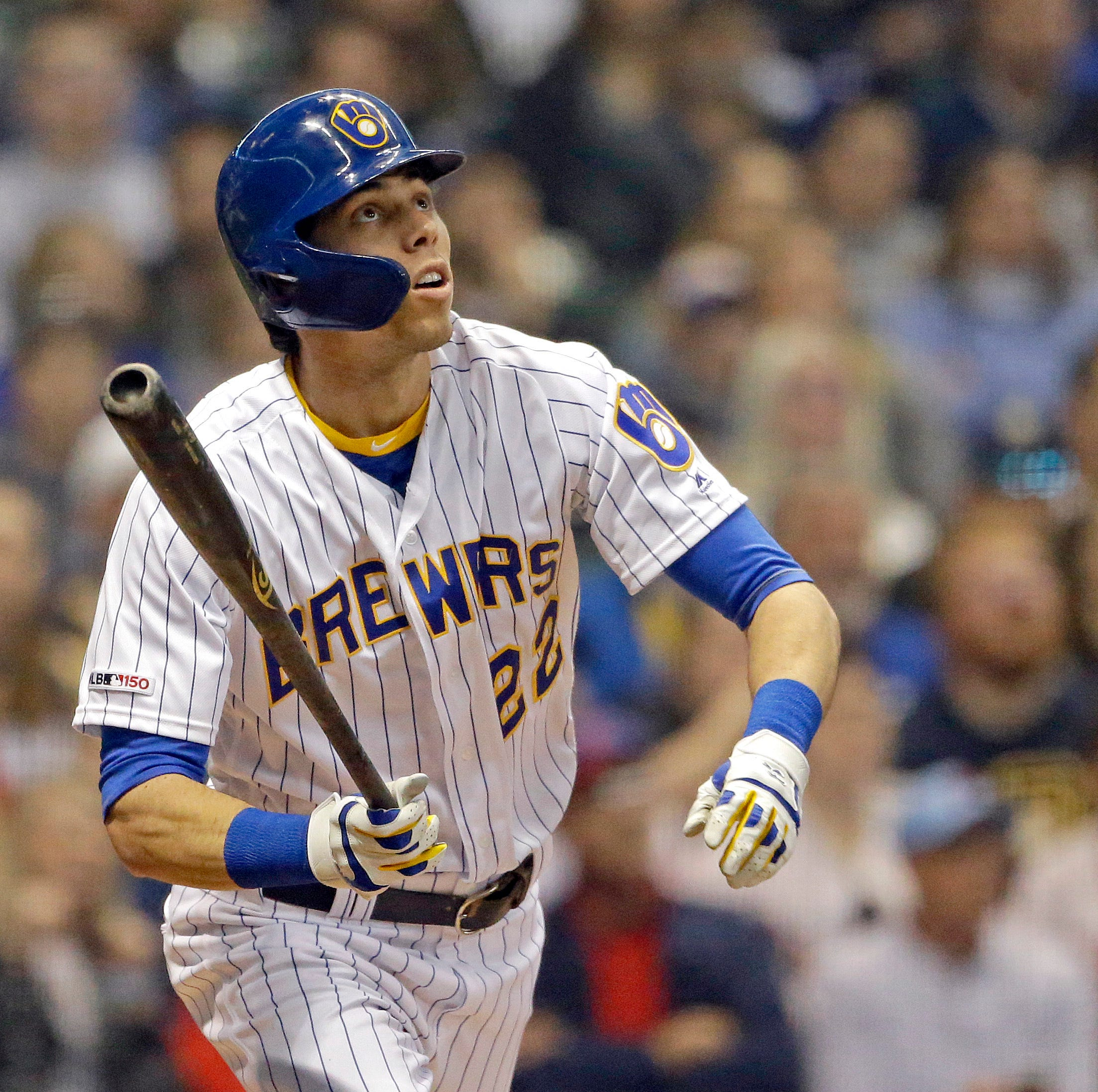 The Brewers' Christian Yelich watches his solo...