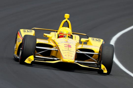 Helio Castroneves drives through Turn 1 on Friday during the final practice session before  the 103rd running of the Indianapolis 500.