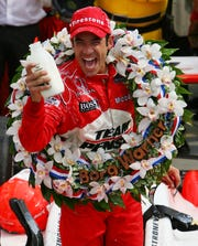 Helio Castroneves celebrates his third Indy 500 victory after the 2009 race.