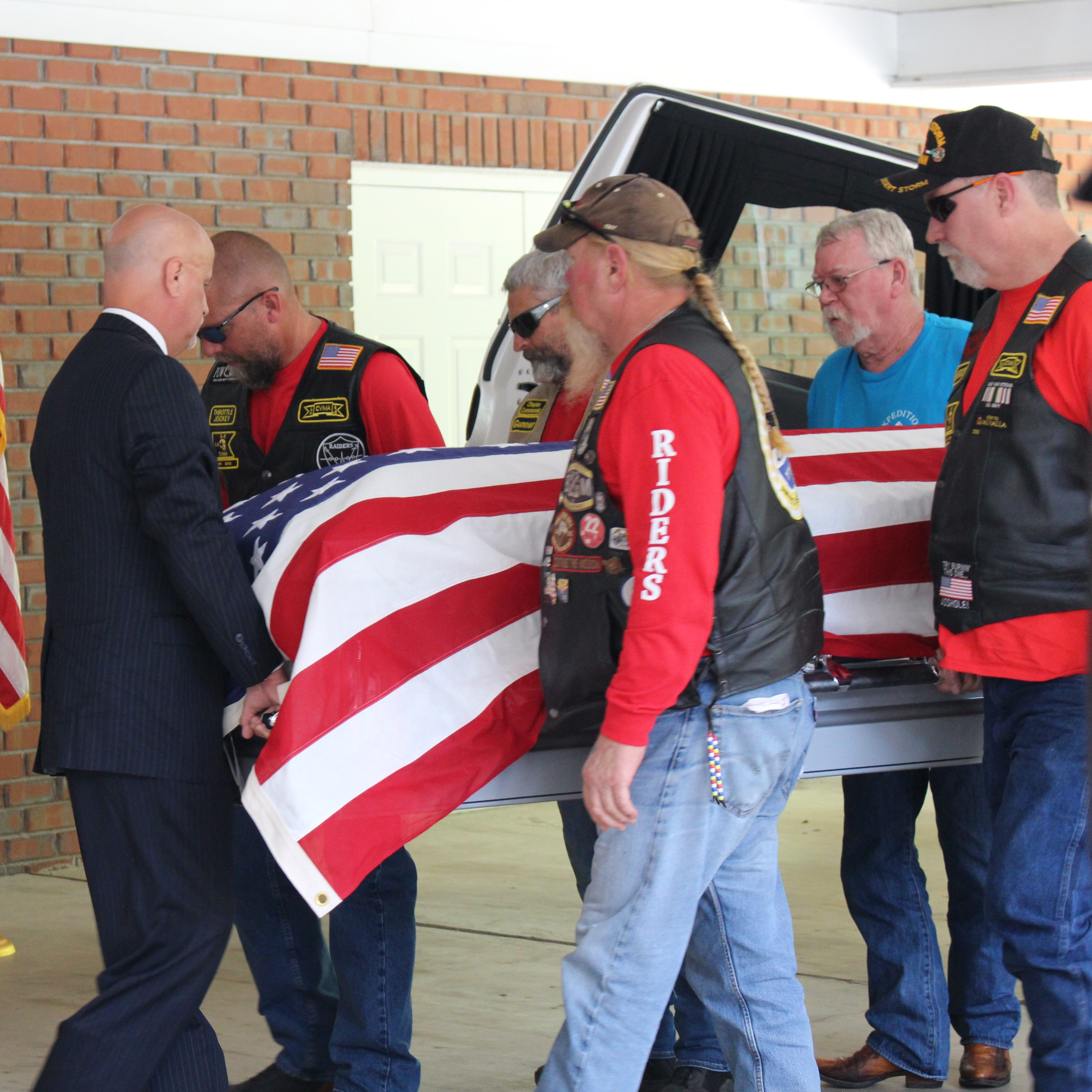The remains of Seaman 1st Class Richard Leon Watson are carried into  Golden Funeral Home in Bastrop. A funeral was held for Watson on Saturday.