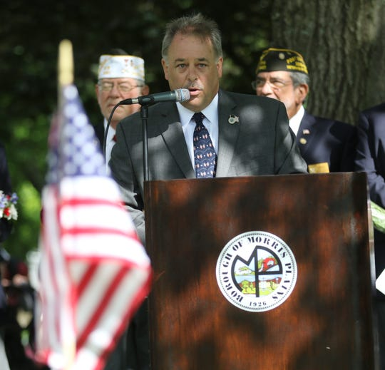 Morris Plains Mayor Jason Karr delivers a welcome for those attending wreath laying service at Roberts Park.