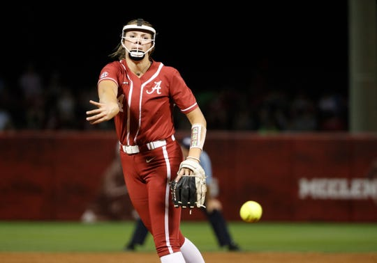 Alabama freshman Montana Fouts (14) delivers a pitch during Friday's 7-5 loss to the Longhorns in Game 2 of the Tuscaloosa Super Regional on May 24, 2019 from Rhoads Stadium in Tuscaloosa. (Photo by Robert Sutton/Alabama athletics)