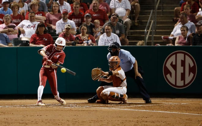Alabama sophomore Kaylee Tow (12) swings at a pitch in front of Texas catcher Mary Iakopo during Friday's 7-5 loss to the Longhorns in Game 2 of the Tuscaloosa Super Regional on May 24, 2019 from Rhoads Stadium in Tuscaloosa. (Photo by Robert Sutton/Alabama athletics)