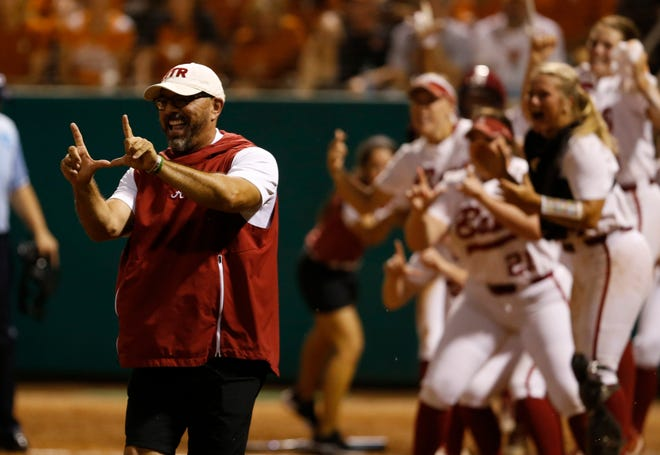 Alabama head coach Patrick Murphy celebrates Merris Schroder's third-inning two-run home run during Thursday's 3-0 win over No. 9 Texas in the first game of a best-of-three Tuscaloosa Super Regional on May 23, 2019 from Rhoads Stadium in Tuscaloosa. (Photo by Noah Sutton/Alabama athletics)