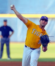 LSU pitcher Clay Moffitt throws during the first inning of the Southeastern Conference tournament NCAA college baseball game against Mississippi State, Friday, May 24, 2019, in Hoover, Ala. (AP Photo/Butch Dill)
