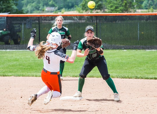 Yorktown's Lexie Robertson attempts an out at second against Hamilton Heights during their sectional championship game at Hamilton Heights High School Saturday, May 25, 2019.