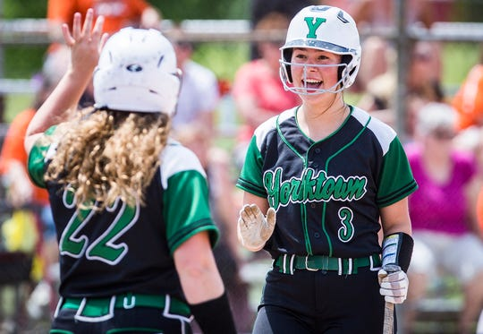 FILE -- Hannah Avila (right) and Caitlyn Grim (left) played significant roles in Yorktown's regional championship. The Tigers are now one step closer to state.