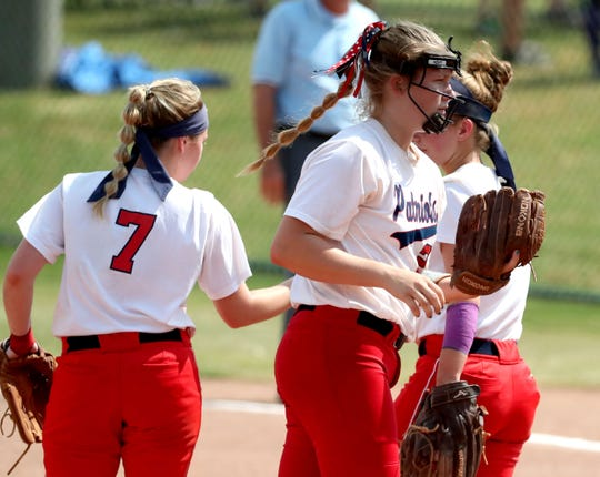 Jefferson County's Santanna Hall (7) and Jefferson County's Abbie Ferguson (6) greet each other as Jefferson County's Catelyn Riley (24) gets ready to pitch during the Class AAA State Girls Softball first Championship game against Siegel on Friday, May 24, 2019, on the last day of Spring Fling, in Murfreesboro.