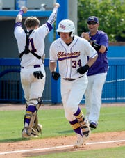 Covington's Kyle Ginn, cries as he runs for home after hitting a two-run home run against Forrest during fourth inning of an TSSAA Class AA State Baseball Tournament championship game Friday, May 24, 2019, in Murfreesboro, Tenn.