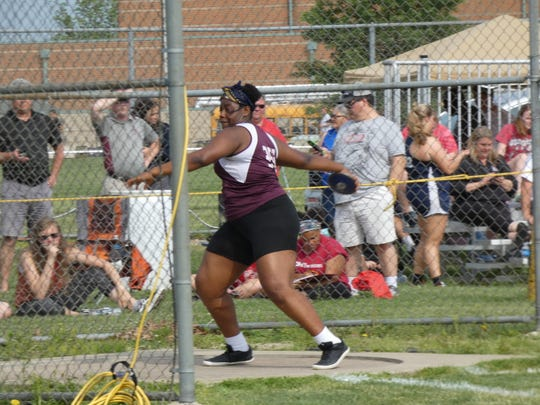 Licking Heights freshman Denara Mbouge competes in the discus May 24 during the Division I regional meet at Pickerington North. Coach Alyson Wand says Mbouge's teammates took note of her impressive season.