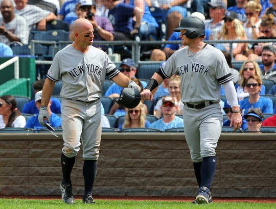 May 25, 2019; Kansas City, MO, USA; \New York Yankees left fielder Brett Gardner(11) celebrates with right fielder Clint Frazier(77) after scoring against the Kansas City Royals during the eighth inning in the first game of a double header at Kauffman Stadium.