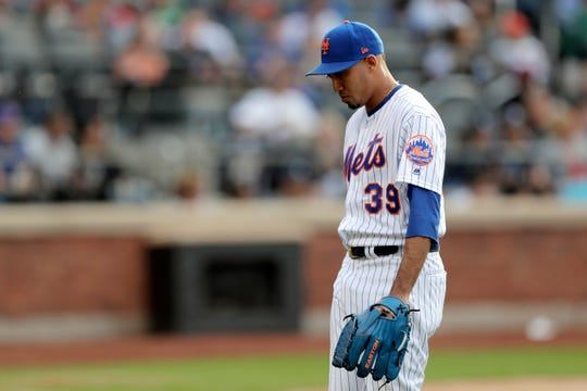 New York Mets' Edwin Diaz heads to the dugout after pitching to the Detroit Tigers in the eighth inning of an interleague game, Saturday, May 25, 2019, in New York.