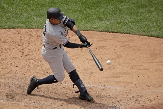New York Yankees' Thairo Estrada hits a two-run double during the eighth inning of the first baseball game in a doubleheader against the Kansas City Royals, Saturday, May 25, 2019, in Kansas City, Mo.
