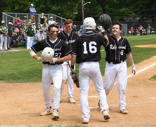 Ridgewood vs. St. Joseph in the Bergen County baseball tournament championship game on Saturday, May 25, 2019. (left) RW #27 Bret Thompson and #11 Sam Favieri after scoring on a homerun hit by (right) RW #8 Brian Skettini.