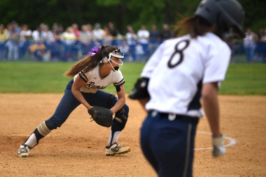 Northern Valley Old Tappan plays Ramsey at Mahwah for the 2019 Bergen County softball tournament final on Saturday May 25, 2019. R#14 Victoria Sebastian  catches the ball as OT#8 Calista Zahos runs to first base.